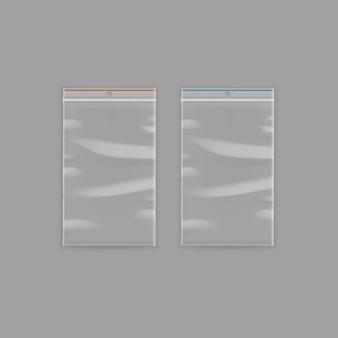 Satz versiegelte leere transparente kunststoff-reißverschlusstaschen nahaufnahme isoliert auf hintergrund