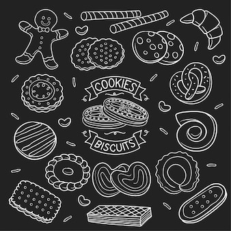 Satz von gekritzelplätzchen und -keks in der tafel