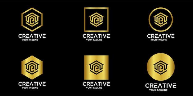 Satz von home logo kombiniert mit buchstaben e gold
