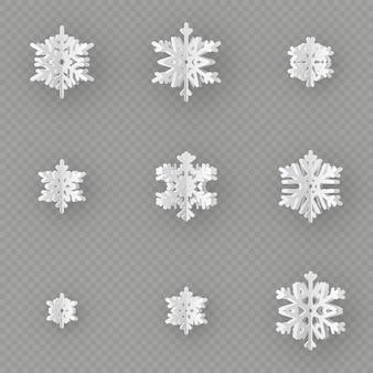 Satz von neun verschiedenen papierschneeflocken, die vom papier auf transparentem hintergrund geschnitten werden. frohe weihnachten, neujahrswinterthema-dekorationsobjekt.