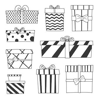 Satz von vektor isolierten doodle-icons von boxen mit bögen. feiertagslinie kunstgeschenke mit bändern, verziert mit kreisen, linien und zickzack.