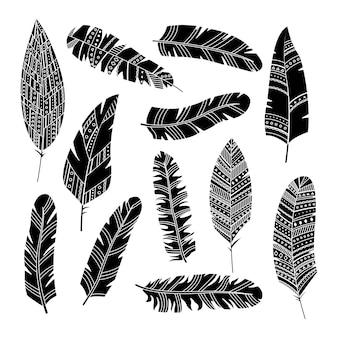 Satz von vektorfedern im boho-stil mit geometrischen ornamenten. einfacher stil