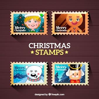 Satz von vier weihnachtsstempeln mit weihnachtscharakteren