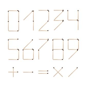 Satz von zahlen eins zwei drei vier fünf fünf sechs sieben acht neun null mit mathematikzeichen aus braunen streichhölzern nahaufnahme oben auf weißem hintergrund