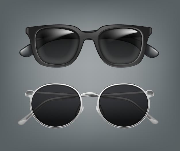 Satz von zwei herren-sonnenbrillen in der vorderansicht des schwarzen und metallrahmens, nahaufnahme, lokalisiert auf grauem hintergrund