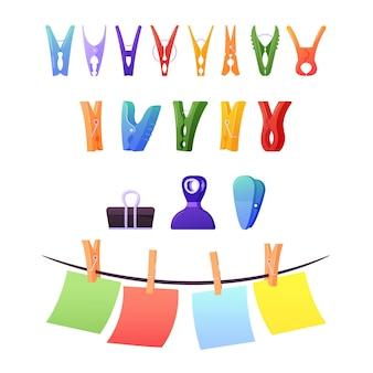 Satz wäscheklammern, clips und heringe. bunte papierbögen hängen am seil