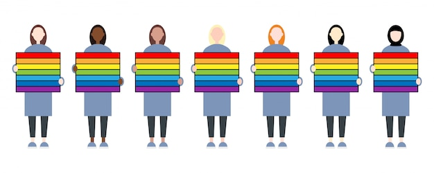 Satz weibliche charaktere des rennens, die ein regenbogenzeichen halten