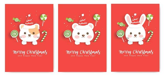 Satz weihnachtsgrußkarten mit niedlichem bären, kaninchen und katze.