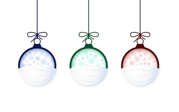 Satz weihnachtskugel in gesichtsmaske.