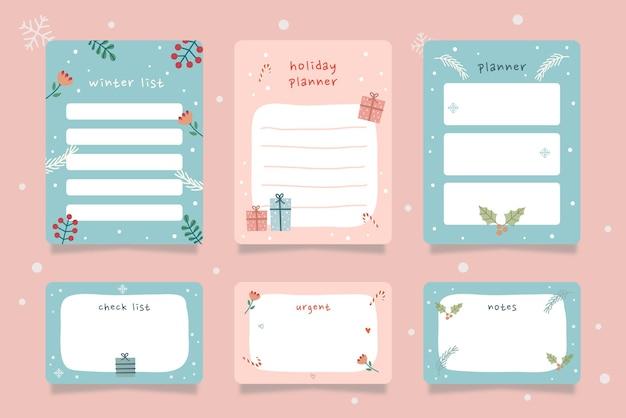 Satz winterferienplanerkarten mit handgezeichneter illustration der blauen rosafarbenen farben.