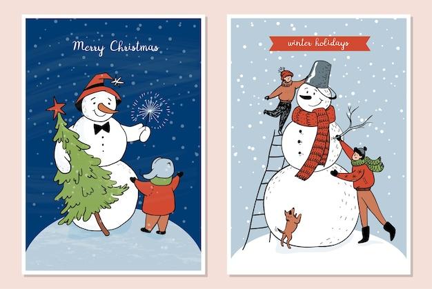 Satz winterkarten mit schneemann und kindern