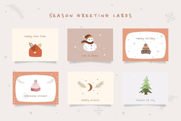 Satz winterurlaub-grußkarten mit brauner cremefarben handgezeichneter illustration.