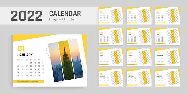 Saubere und moderne designvorlage für den neujahrstischkalender 2022 Premium Vektoren