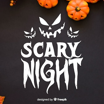 Scary night schriftzug mit kürbissen