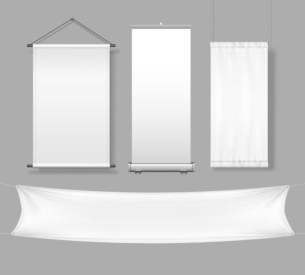 Schablone der weißen leeren stoff- und papierfahnen und des schildes mit roll-up-anzeige und messestand lokalisiert auf grauem hintergrund.