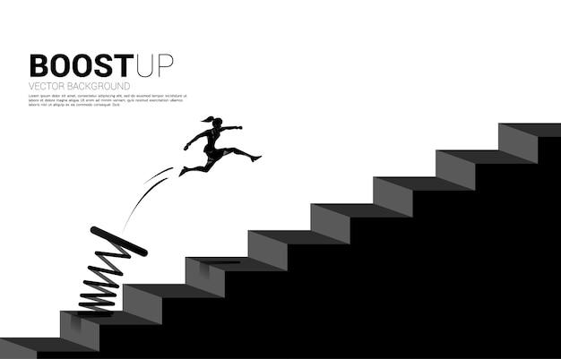 Schattenbild der geschäftsfrau, die springt, um schritt mit sprungbrett zu passieren