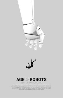 Schattenbild der geschäftsfrau, die von der roboterhand herunterfällt.