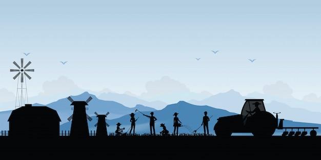 Schattenbild des bauern, der einen traktor in ackerland fährt.