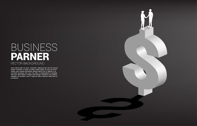 Schattenbild des geschäftsmann-handshakes auf dollarwährungssymbol. konzept für die finanzielle partnerschaft von unternehmen.