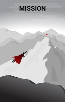 Schattenbild des geschäftsmannes, der zum gipfel des berges fliegt. geschäftskonzept für start-up und schnell wachsendes unternehmen.