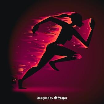 Schattenbild des läufers in den flammen