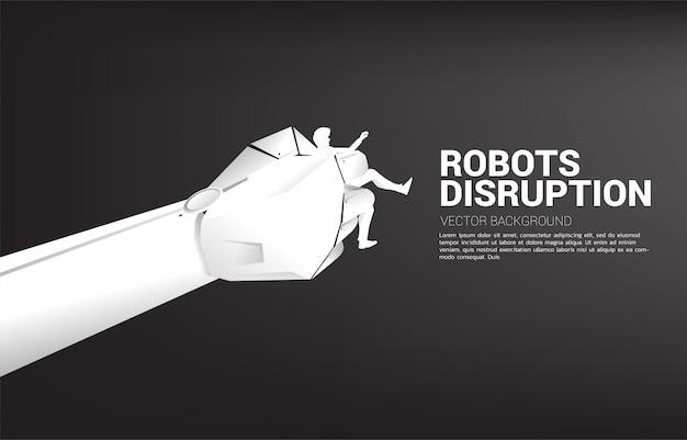 Schattenbild des mannes in der roboterhandholding