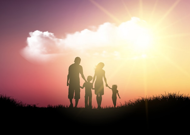 Schattenbild einer familie, die gegen einen sonnenunterganghimmel geht