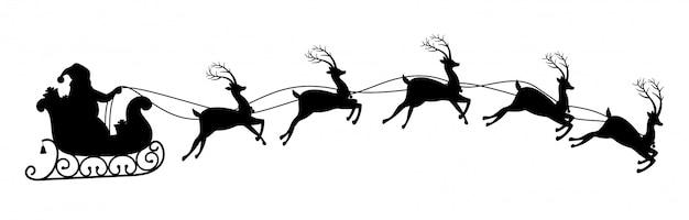 Schattenbild von weihnachtsmann reitend auf renpferdeschlitten.