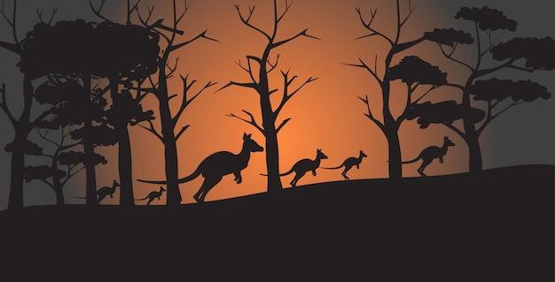 Schattenbilder von den kängurus, die von den waldbränden in australien-tieren sterben im naturkatastrophenkonzept des verheerenden feuers bushfire horizontal laufen
