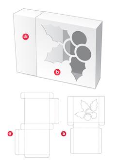 Schiebebox mit gestanzter schablone in form von weihnachtsstechpalmenfenstern