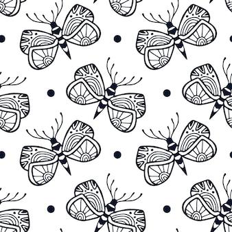 Schmetterlinge nahtloses muster im dekorativen handgezeichneten stil. textildesign mit blockdruck und süßem schwarz-weißem schmetterling.