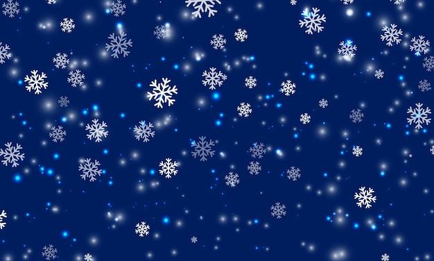 Schnee-hintergrund. schneefall im winter. weiße schneeflocken am blauen himmel. weihnachten hintergrund. fallender schnee.