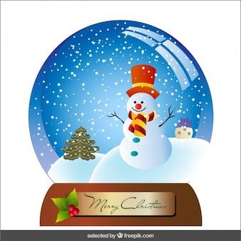 Schneeball mit schneemann und weihnachtsbaum