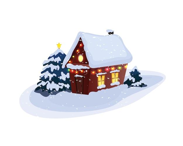 Schneebedecktes landhaus mit weihnachtsbäumen.