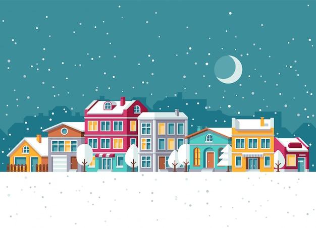 Schneefälle in der winterstadt mit karikaturvektorillustration der kleinen häuser. weihnachtsferien-konzept