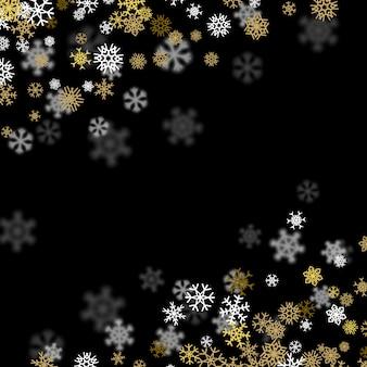 Schneefallhintergrund mit den goldenen schneeflocken verwischt in der dunkelheit