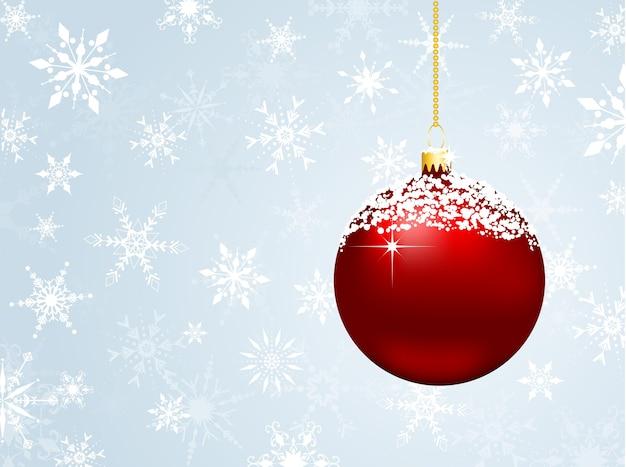 Schneeflocke mit schneebedeckter weihnachtskugel