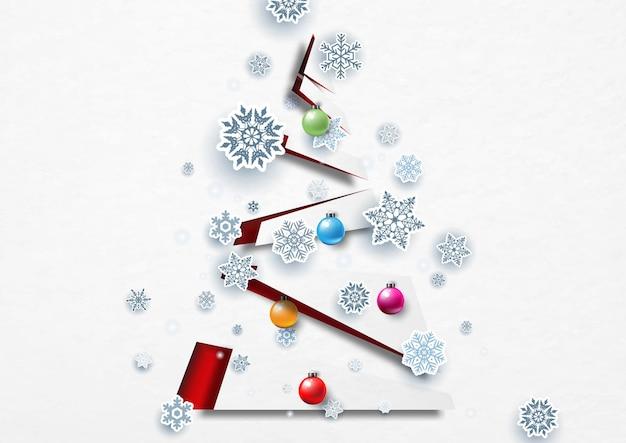 Schneeflocke mit weihnachtskugeln auf modernem und abstraktem weihnachtsbaum im scherenschnitt-stil auf weißem papiermusterhintergrund