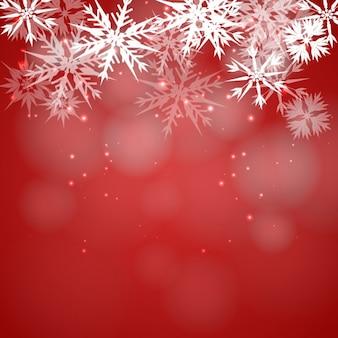 Schneeflocken auf einem roten hintergrund bokeh