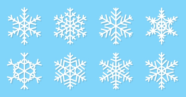 Schneeflocken flach eingestellt. schneesymbole unterschiedlicher form.