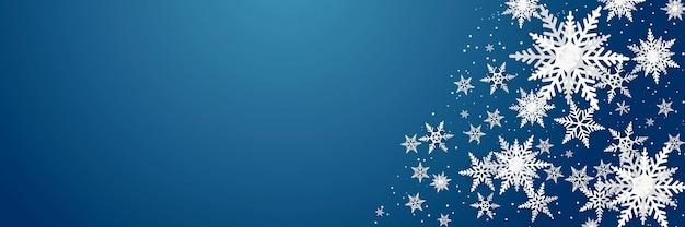 Schneeflocken-luxusmuster auf blauem hintergrund. modernes design für weihnachts-, winter- oder neujahrshintergrundmaterial, abstrakte schneeflockendekoration für grußkarte, verkaufsfahne