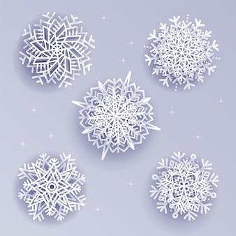 Schneeflocken stellten in art des volumens 3d auf weißem silber ein