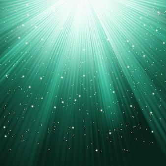 Schneeflocken und sterne, die auf einem weg des grünen lichts herabsteigen. datei enthalten
