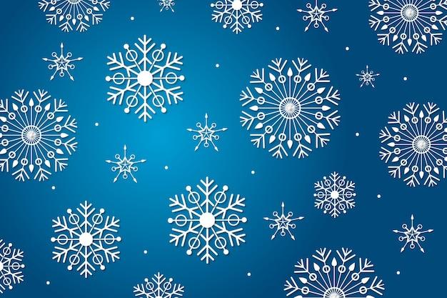 Schneeflockenhintergrund im papierstil