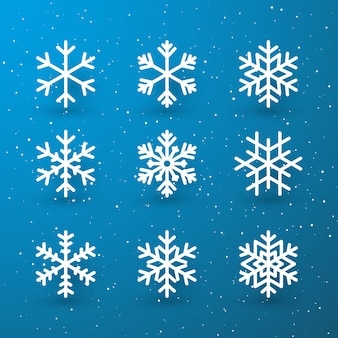 Schneeflockenwinter-satz der weißen lokalisierten symbolschattenbild auf blauem hintergrund.