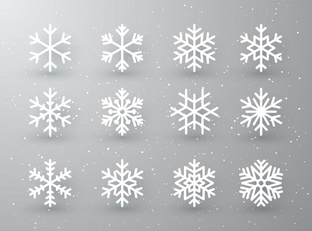Schneeflockenwinter-satz der weißen lokalisierten symbolschattenbild auf weißem grauem hintergrund.