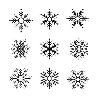 Schneeflockenwintersatz schwarzes lokalisierte das design mit neun ikonen