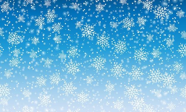 Schneehintergrund. winterschneefall. weiße schneeflocken am blauen himmel. weihnachtshintergrund. fallender schnee.
