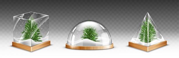 Schneekugeln mit weihnachtsbaum auf hölzerner basis lokalisiert auf transparentem hintergrund