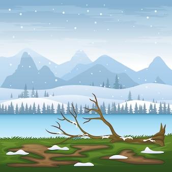 Schneelandschaft im winter mit umgestürztem baum am fluss